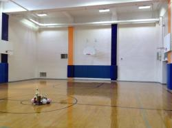 Here's the Boys' Gym with an assortment of trophies on the floor.